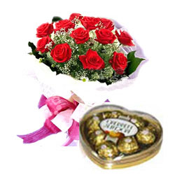 A dozen red roses bouquet with small box of heart chocolate