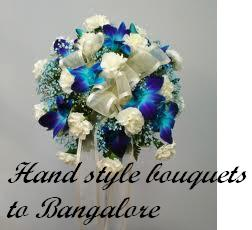 hand bouquet of blue orchids and white roses