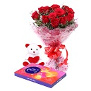 A dozen red roses with Teddy and a Celebration Pack